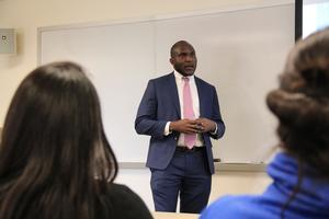 Brice Ngameni speaking in class.