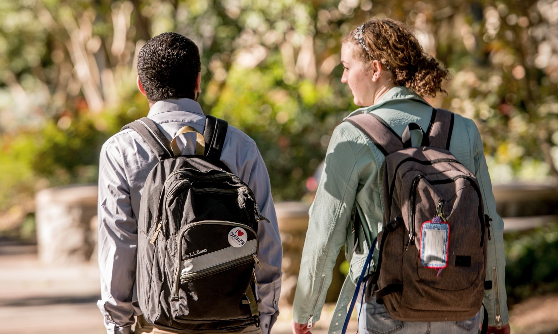 Two students walking on campus together