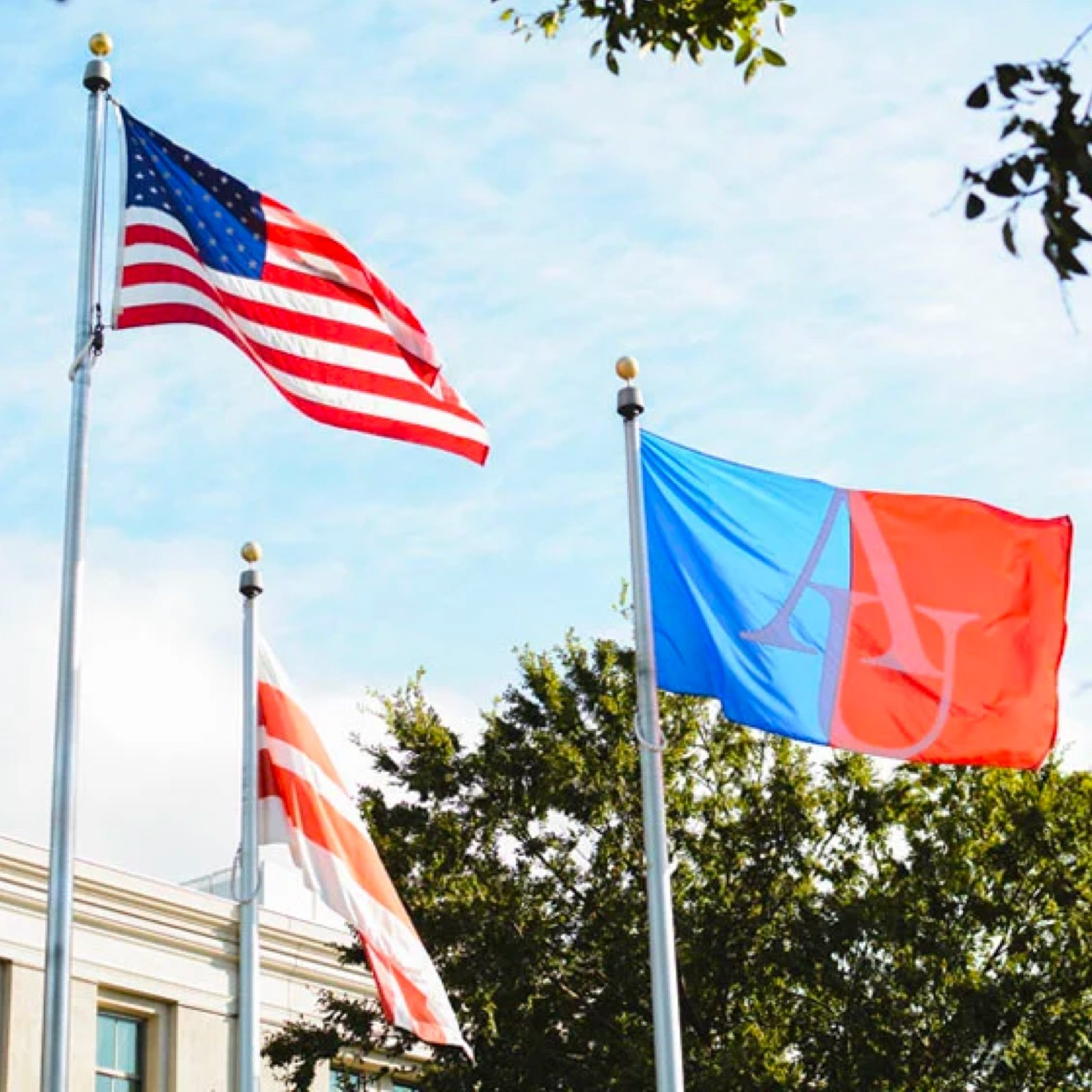 US, DC, and American University flags on campus