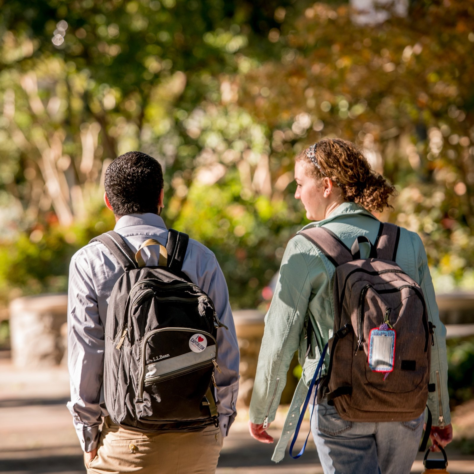 Two students walking together on campus
