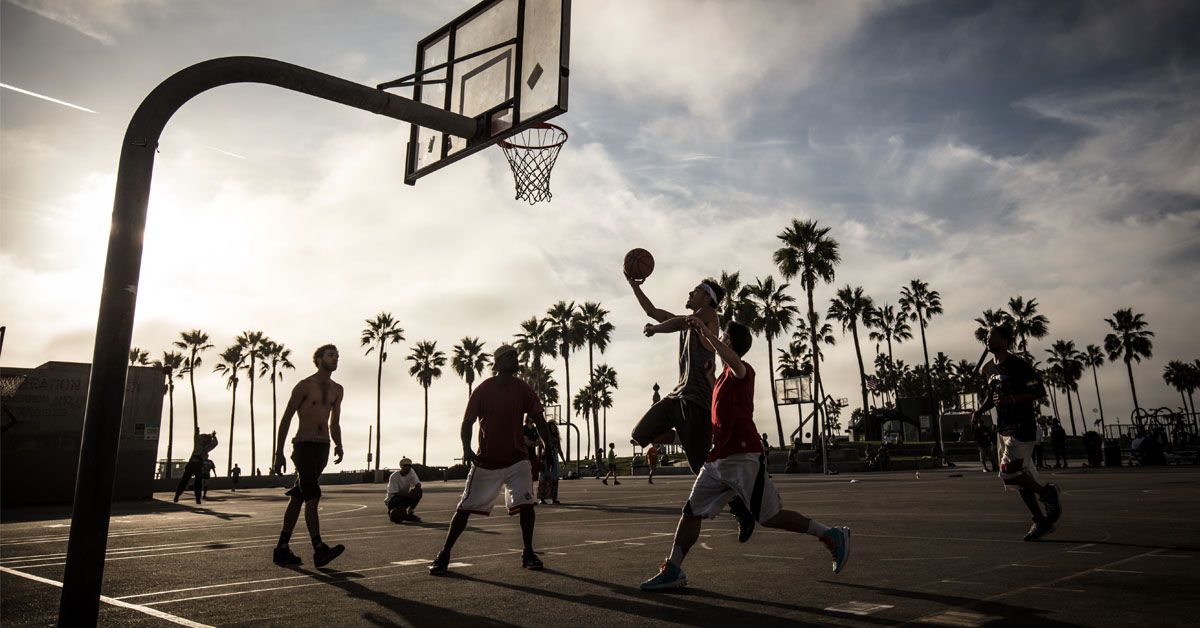 A game of people playing basketball
