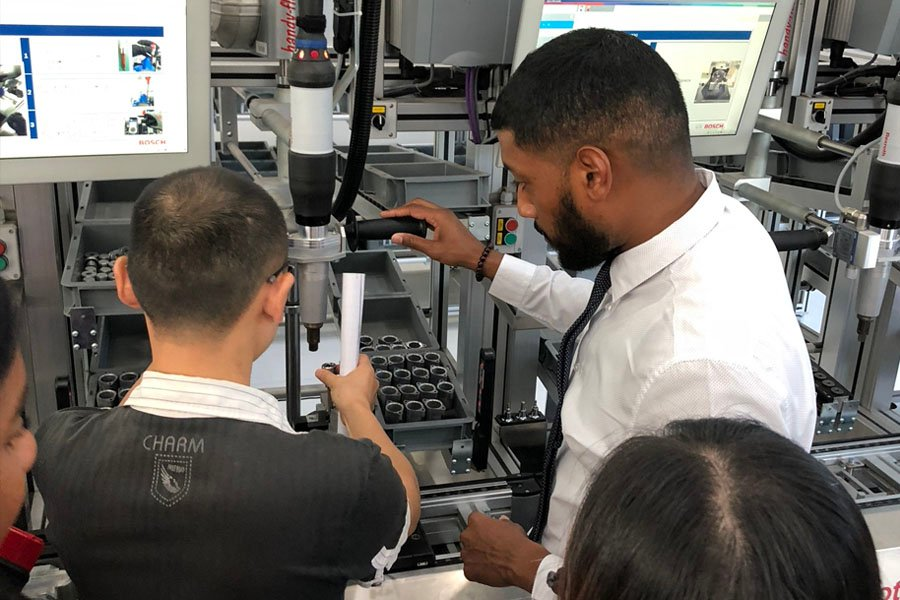 Students learning how to operate machinery